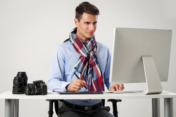 Photographer working on computer