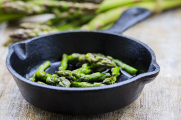 Asparagus on frying pan