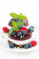 cakes with fruit jelly and fresh berries