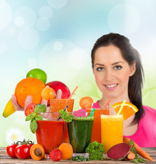 Young happy woman with Fresh fruit juice.