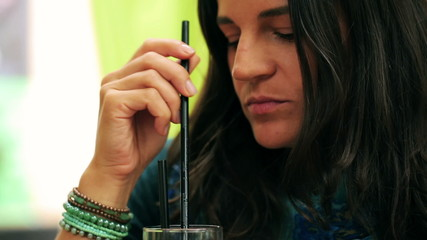 Woman drinking beverage in restaurant, steadycam shot