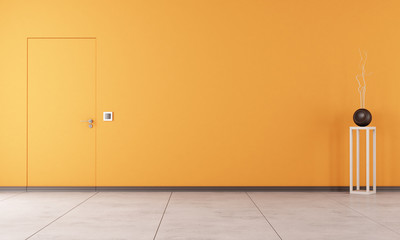 Empty orange room with door