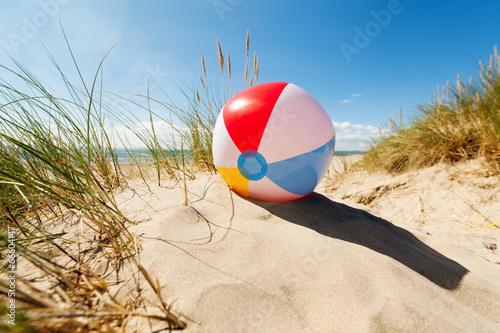 Leinwandbild Motiv Beach ball in sand dune