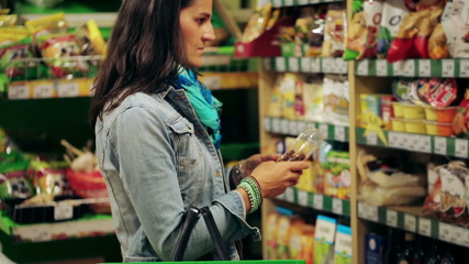 Woman shopping in delicatessen, steadycam shot