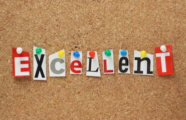 The word Excellent on a cork notice board