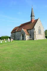 English church on green lawn