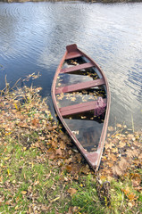 retro wooden boat in autumn