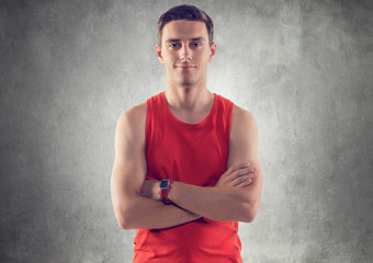 Portrait of muscular young handsome sportsman athlete wearing a