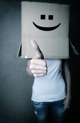 faceless girl with box on her head LIKE with thumb up, social ne