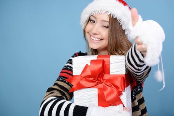 happy christmas girl with thumb up, young beautiful woman smilin