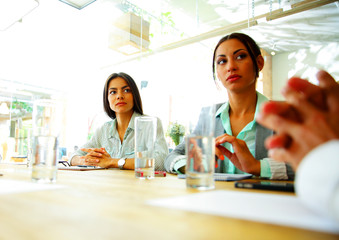 Businesspeople sitting at the table during a meeting in office