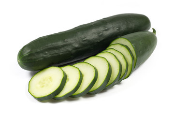 Fresh cucumber and slices isolated on a white background
