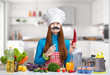 Female chef with paper moustache and the red pepper