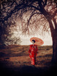 Walking woman with umbrella – asian style portrait