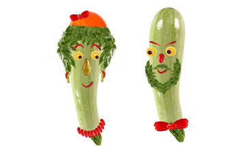 Two funny portrait of men and women, made from zucchini and fr
