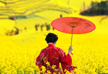Woman in red kimono walking away, view from back