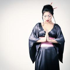 Young beautiful asian woman's portrait, studio shot toned