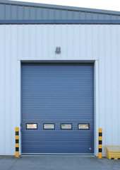 Factory loading bay roller door on industrial building