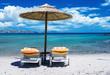 Colourful beach umbrella and chairs on a beautiful beach