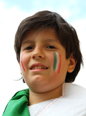 portrait  of a young supporter before the football match of the