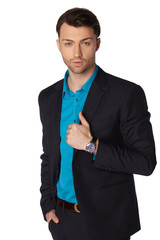 Young businessman black suit casual poses