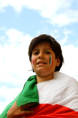 boy with painted flag before the football match