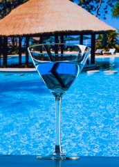 fresh blue cocktail near pool