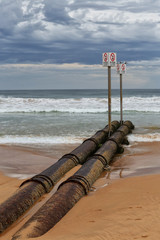 Waste water pipe running into the ocean