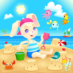 Young rabbit makes castles on the beach.