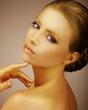 Classy Fashion Model Painted Gold. Satiny Bronzed Skin