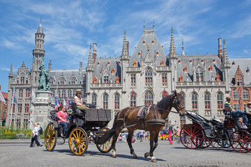 Brugge - Carriage on the Grote Markt and the Provinciaal Hof