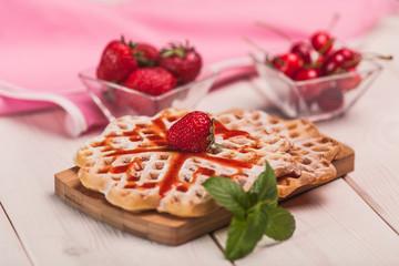 Sweet breakfast on wooden desk