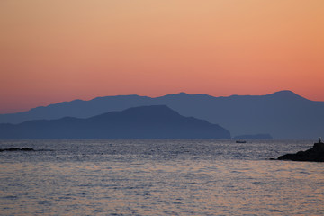 Distant mountains at dusk seascape view