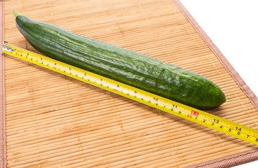 Big yellow centimeter and big green cucumber.