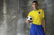 Young Brazilian Footballer in Kit Holding Football