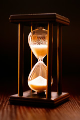 Illuminated hourglass in a wooden frame
