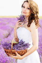 Beautiful bride posing at field of lavender