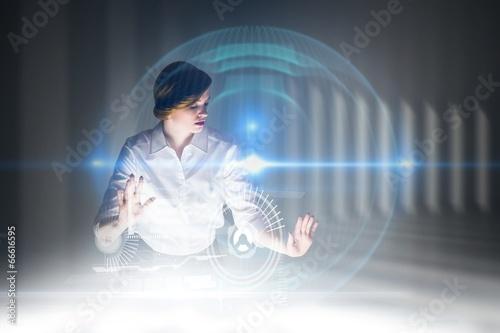 Composite image of redhead businesswoman using interactive desk