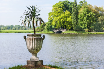 Urn with plant by the water in Germany.