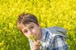 Portrait of a boy on a rapeseed field