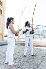 Capoeira, berimbau musical instrument in their hands