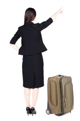 Back view of young brunette business woman traveling with suitca
