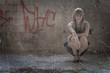 Women on high heels sitting inside slums a lot of copyspace