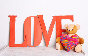 Decorative letters forming word LOVE with teddy bear