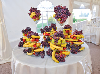 Fruits arrangement on restaurant table. Wedding decoration