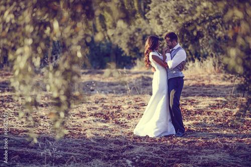 Leinwanddruck Bild Just married couple in nature background