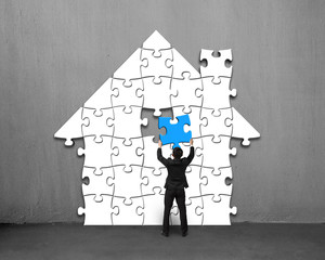 Assembling blue puzzles into house shape