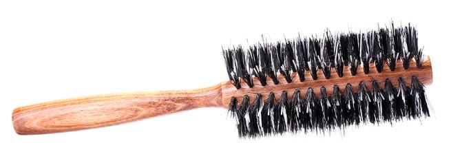 Wooden hairbrush isolated on white