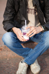 Young man drinking a milk shake