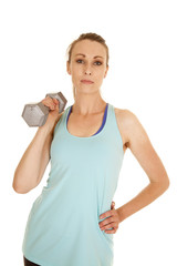 woman blue tank top weight by shoulder